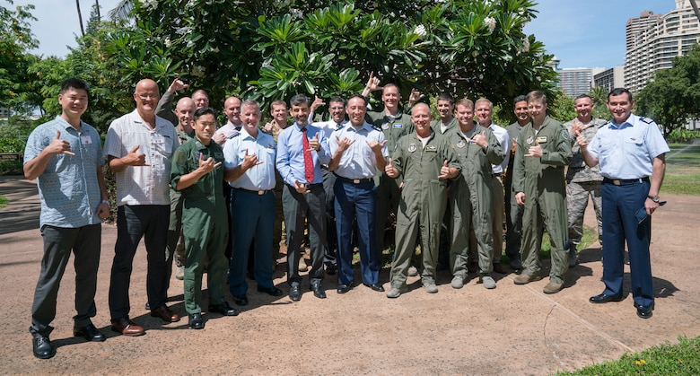 Attendees of the Asia-Pacific Aviation Safety Subject Matter Expert Exchange (APASS) pose for a photo together in Honolulu, Hawaii, Aug. 14, 2018. APASS allows partner nations in the Indo-Pacific to discuss aviation safety practices and devise solutions to challenges faced by the various air forces. (U.S. Air Force photo by Staff Sgt. Daniel Robles)