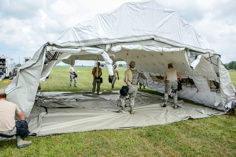 Airmen with the 115th Fighter Wing Fatality Search and Rescue Team set up a mobile workstation for the Wisconsin Chemical, Biological, Radiological, Nuclear and High Yield Explosive Enhanced Response Force Package External Evaluation exercise at Volk Field Air National Guard Base, Aug. 16, 2018. The ExEval is conducted as a way to re-validate the WI CERFP to perform its CBRN Response Enterprise mission in support of the State and Nation. (U.S. Air National Guard photo by Tech. Sgt. Mary E. Greenwood)