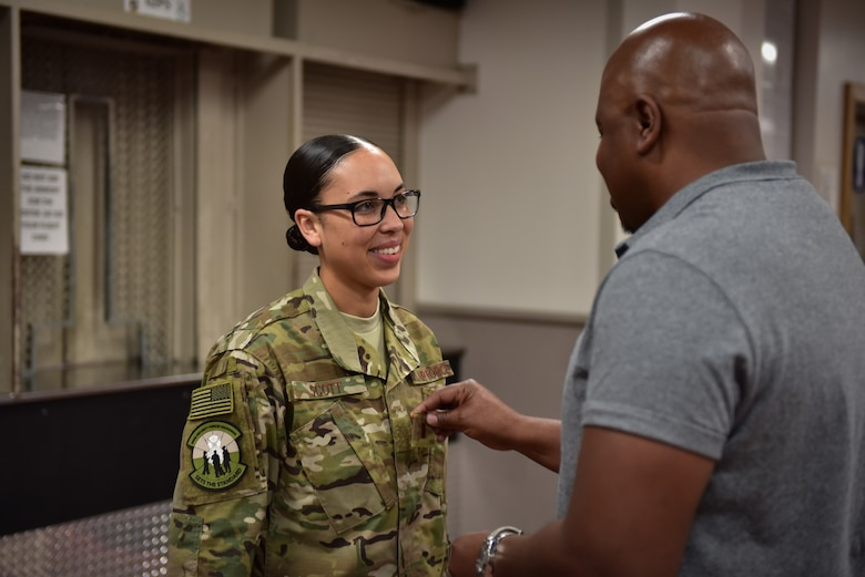 Former Staff Sgt. Jasmine Scott, a member of the 509th Security Forces, receives her second lieutenant rank patch from her father, Ray Deauvearo, Aug. 10, 2018, at Whiteman Air Force Base, Mo. Scott earned her commission as a health services administrator and will attend a five-and-a-half-week Commissioned Officer Training course before starting her first medical assignment. (U.S. Air Force photo by Tech. Sgt. Alexander W. Riedel)