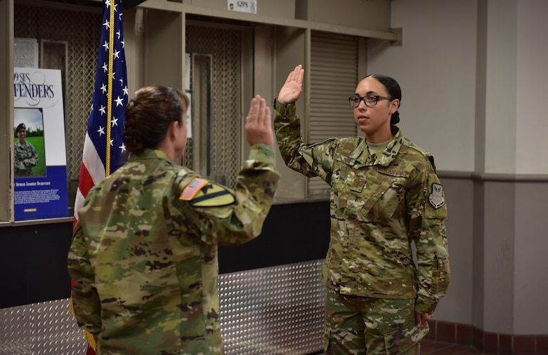 U.S. Army Maj. Darla Deauvearo, left, administers the oath of office to her daughter 2nd Lt. Jasmine Scott, Aug. 10, 2018, at Whiteman Air Force Base. Scott was a member of the 509th Bomb Wing and commissioned into the medical services field.  (U.S. Air Force photo by Tech. Sgt. Alexander W. Riedel)