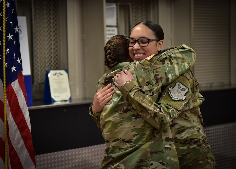 U.S. Army Maj. Darla Deauvearo, left, hugs her daughter 2nd Lt. Jasmine Scott, Aug. 10, 2018, after she read her the oath of office during a commissioning ceremony at Whiteman Air Force Base. Scott was a member of the 509th Bomb Wing and commissioned into the medical services field.  (U.S. Air Force photo by Tech. Sgt. Alexander W. Riedel)