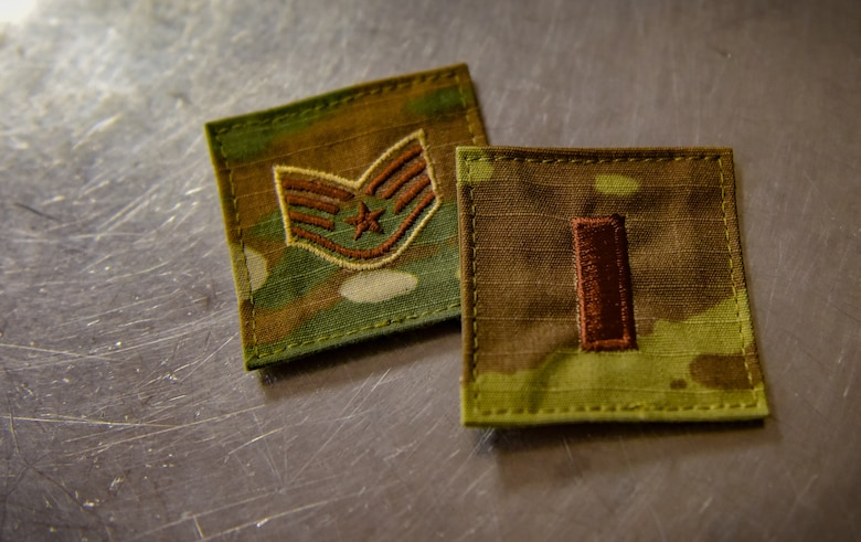 Two rank patches worn on the same day by 2nd Lt. Jasmine Scott, Aug. 10, 2018, at Whiteman Air Force Base, Mo. Scott commissioned into the medical services corps, after serving as an enlisted armorer at the 509th Security Forces Squadron. (U.S. Air Force photo by Tech. Sgt. Alexander W. Riedel)