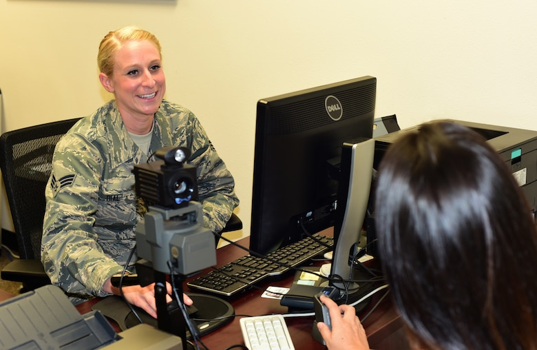 U.S. Air Force Senior Airman June Dial, 44th Fighter Group personnel specialist, assists a customer with making a new common access card, August 14, 2018, at Tyndall Air Force Base, Florida. As part of the 44th FG, Dial is part of a larger mission of training and projecting unrivaled 5th-generation combat airpower through mission ready Citizen Airmen. Though traditionally a reservist, she and her fellow 44th FG Airmen work side-by-side with active-duty Airmen to provide world class support of missions and increase the Air Force's readiness. (U.S. Air Force photo by Senior Airman Cody R. Miller)