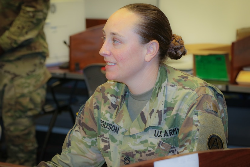 Sgt. 1st Class Heather Ferguson, a signal operations chief at U.S. Army Central, listens to the course instructor during her participation in the Battle Staff Noncommissioned Officers Course at USARCENT headquarters on Shaw Air Force Base, S.C., July 27, 2018. BSNCOC provides technical and tactical curriculum relevant to the missions, duties and responsibilities assigned to battle staff members.