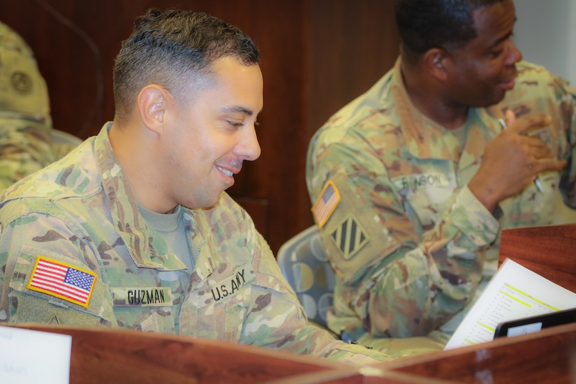 (Pictured left) Staff Sgt. Eric Guzman, an air missile defense operations sergeant at the 2503rd Digital Liaison Detachment, U.S. Army Central, reviews a document during his participation in the Battle Staff Noncommissioned Officers Course at USARCENT headquarters on Shaw Air Force Base, S.C., July 27, 2018. BSNCOC provides technical and tactical curriculum relevant to the missions, duties and responsibilities assigned to battle staff members.