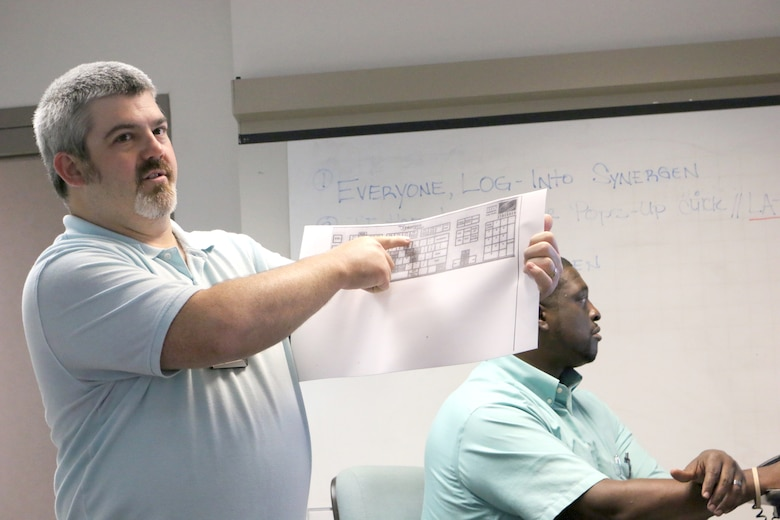 Test Operations Engineer and Ground Test University instructor Bernie Williamson discusses Synergen system hot keys during a recent GTU class. Also pictured is fellow GTU instructor Julius Lockett, a systems engineer in the Engine Test Facility. The purpose of GTU is to provide younger members of the AEDC workforce and their more-tenured counterparts in new positions with knowledge and information to help them more effectively complete job tasks. (U.S. Air Force photo by Bradley Hicks) (This image was manipulated by obscuring badges for security purposes)