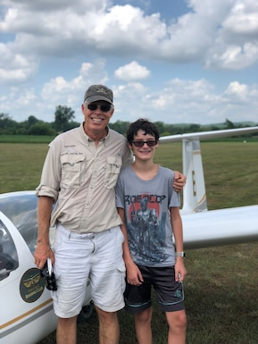 Middle school student Christian Davis, right, had the chance to fly recently with the Eagleville Soar Club after completing the Fly to Learn course, which is a 10-lesson curriculum using virtual airplanes to simulate flight. Pictured with Davis is his instructor pilot Jere Matty. The Fly to Learn Aviation Program is sponsored by Arnold Air Force Science, Technology, Engineering and Mathematics Program. (Courtesy photo)
