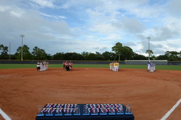 PENSACOLA, Fla.-- Teams gather for the closing ceremonies of the 2018 Women's Armed Forces Softball Championship, Aug. 15-17. Teams from the Navy, Army and Marine Corps tried to dethrone the defending champion Air Force team, but the Air Force ladies win gold for a second year(. (U.S. Navy photo by Mass Communication Specialist 2nd Class Timothy A. Hazel/Released)