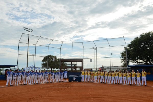PENSACOLA, Fla. -- The All-Air Force and All-Army teams stand during the closing ceremonies for the 2018 Women's Armed Forces Softball Championship, Aug. 15-17. The Air Force team took gold for the second straight year, and the Army took silver. (U.S. Navy photo by Mass Communication Specialist 2nd Class Timothy A. Hazel/Released)