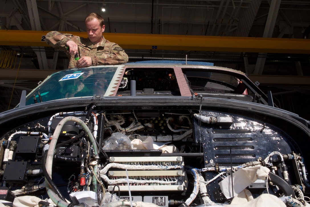 Air Guardsmen conduct phase inspection on HH-60G Pave Hawk.