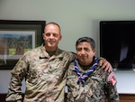West Virginia Army National Guard Command Sgt. Maj. Phillip Cantrell poses for a photo with Técnico Jefe Superior Pedro Espinoza, sergeant major of the Peruvian army Aug. 16, 2018, at the West Virginia National Guard Joint Force Headquarters in Charleston, West Virginia.
