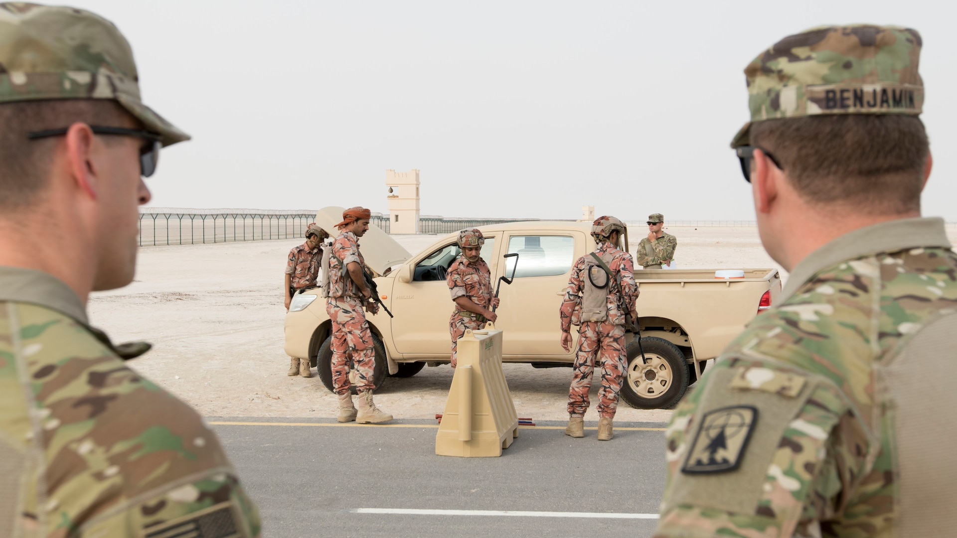 U.S. Army Soldiers with the 157th Military Engagement Team, Wisconsin Army National Guard, attached to U.S. Army Central, observe soldiers from the Royal Army of Oman's Border Guard Brigade performing a vehicle search as part of a practical exercise in which soldiers from each country demonstrated their preferred method of operating a vehicle control point in Haima, Oman, Aug. 8, 2018. The collaborative exercise increased interoperability between the U.S. Army and Omani Army by creating an opportunity for soldiers from each country to share best practices in border security. (U.S. Army photo by Spc. Adam Parent)