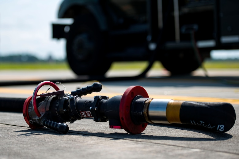 A refuel hose rests on the flightline during a hot pit refueling, Aug. 14, 2018, at Moody Air Force Base, Ga. Members of the 23d Logistics Readiness Squadron preposition fueling trucks to allow aircraft to refuel without needing to shut down. This style of refueling is used to eliminate the need for additional maintenance procedures and to extend pilots' training time per flight which improves operations tempo. (U.S. Air Force photo by Airman 1st Class Erick Requadt)