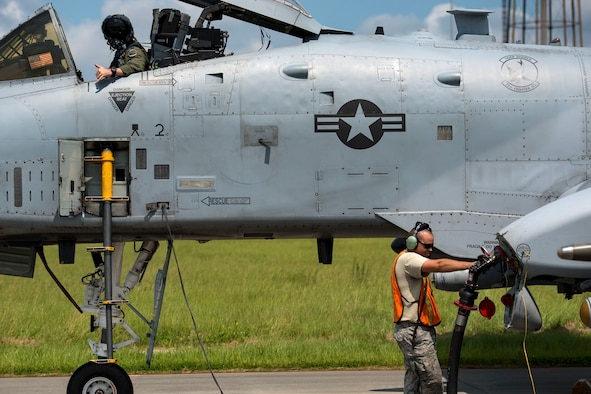 Staff Sgt. Jared Burrus, right, 476th Maintenance Squadron crew chief, flips fuel flow switches on an A-10C Thunderbolt II during a hot pit refueling, Aug. 14, 2018, at Moody Air Force Base, Ga. Members of the 23d Logistics Readiness Squadron preposition fueling trucks to allow aircraft to refuel without needing to shut down. This style of refueling is used to eliminate the need for additional maintenance procedures and to extend pilots' training time per flight which improves operations tempo. (U.S. Air Force photo by Airman 1st Class Erick Requadt)