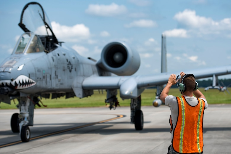 Tech. Sgt. Brandon Hoke, 476th Maintenance Squadron crew chief, marshals an A-10C Thunderbolt II, Aug. 14, 2018, at Moody Air Force Base, Ga. Members of the 23d Logistics Readiness Squadron preposition fueling trucks to allow aircraft to refuel without needing to shut down. This style of refueling is used to eliminate the need for additional maintenance procedures and to extend pilots' training time per flight which improves operations tempo. (U.S. Air Force photo by Airman 1st Class Erick Requadt)