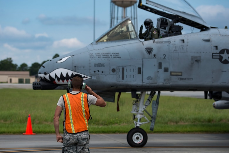 Tech. Sgt. Brandon Hoke, 476th Maintenance Squadron crew chief, renders a salute to a pilot after hot pit refueling an A-10C Thunderbolt II, Aug. 14, 2018, at Moody Air Force Base, Ga. Members of the 23d Logistics Readiness Squadron preposition fueling trucks to allow aircraft to refuel without needing to shut down. This style of refueling is used to eliminate the need for additional maintenance procedures and to extend pilots' training time per flight which improves operations tempo. (U.S. Air Force photo by Airman 1st Class Erick Requadt)