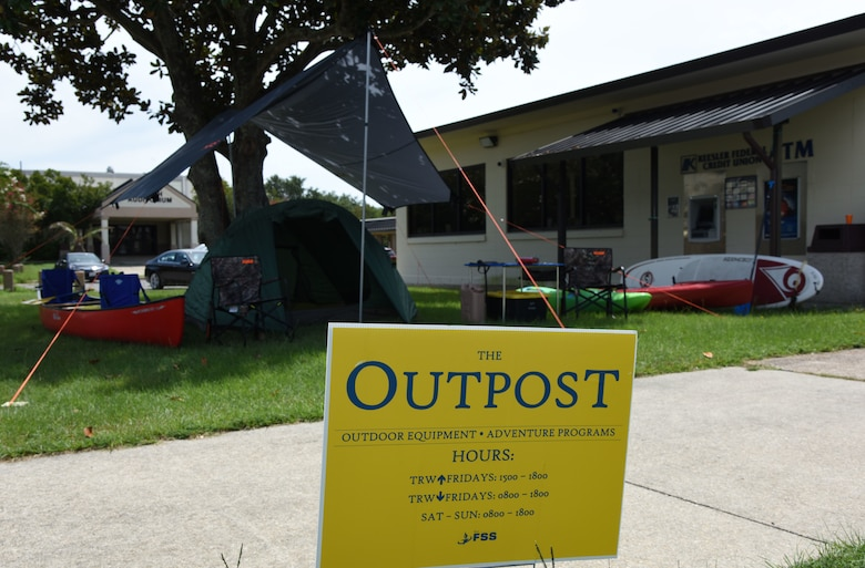 A sign for The Outpost is displayed during the grand opening at the Vandenberg Commons at Keesler Air Force Base, Mississippi, Aug. 17, 2018. The Outpost is a satellite store from the Outdoor Recreation Center with recreation items available for Airmen in the 81st Training Group. (U.S. Air Force photo by Kemberly Groue)