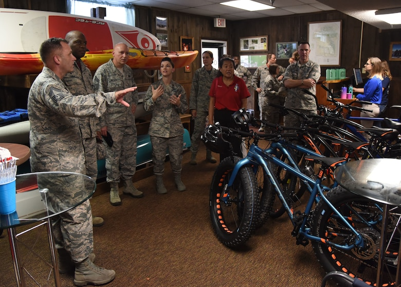 Keesler personnel tour The Outpost during the grand opening at the Vandenberg Commons at Keesler Air Force Base, Mississippi, Aug. 17, 2018. The Outpost is a satellite store from the Outdoor Recreation Center with recreation items available for Airmen in the 81st Training Group. The 81st Force Support Squadron hosted the event. (U.S. Air Force photo by Kemberly Groue)