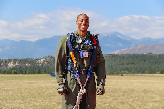 Staff Sgt. Charles Carter poses for a photo after successfully completing one of his five solo parachute jumps as part of the Air Force Academy's Airmanship 490 course.