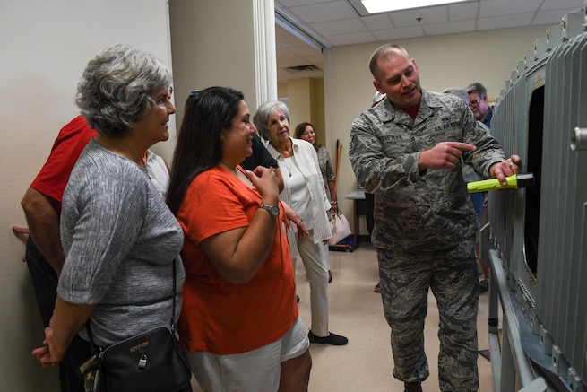 Tech. Sgt. Clinton Shetler, a fuels systems instructor in the 361st Training Squadron, talks to the Lt. Gen. Leo Marquez family about fuel cells training during the family's visit to Sheppard Air Force Base, Texas, Aug. 17, 2018. Marquez was a visionary in Air Force logistics during his time in the service, modernizing it to mission is conducts today. Sheppard is responsible for training many of the career fields that make up the logistics community. (U.S. Air Force photo by Senior Airman Kevin Clites)