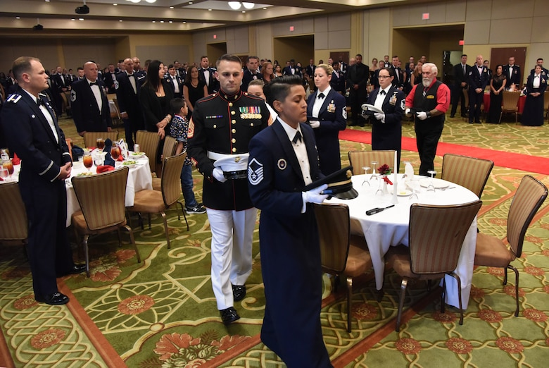 Military and civilian service members participate in a POW/MIA table ceremony during the Senior NCO Induction Ceremony at the Bay Breeze Event Center at Keesler Air Force Base, Mississippi, Aug. 17, 2018. More than 50 inductees were recognized during the event. A medallion ceremony and a candle lighting ceremony also took place during the event. (U.S. Air Force photo by Kemberly Groue)