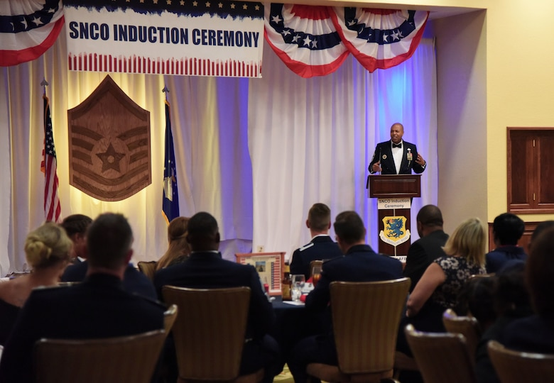 U.S. Air Force Chief Master Sgt. Keith Castille, Headquarters Air Education and Training Command operations superintendent for the profession of arms center of excellence, Joint Base San Antonio-Randolph, Texas, delivers remarks during the Senior NCO Induction Ceremony at the Bay Breeze Event Center at Keesler Air Force Base, Mississippi, Aug. 17, 2018. More than 50 inductees were recognized during the event. (U.S. Air Force photo by Kemberly Groue)