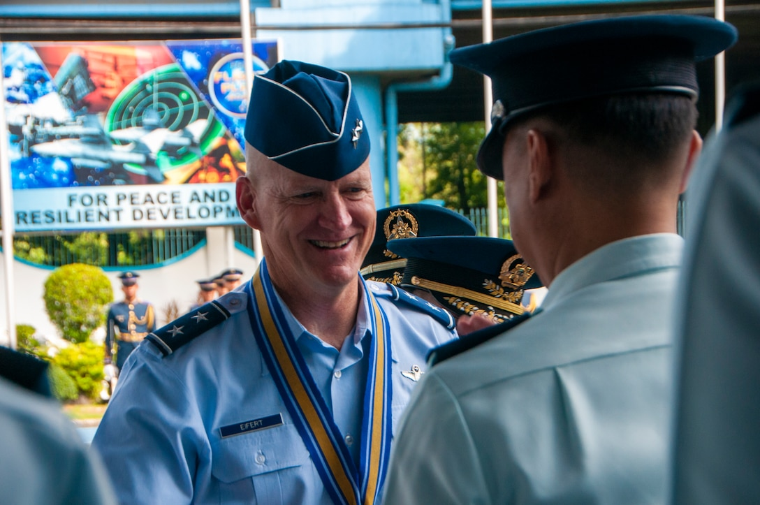 Maj. Gen. James O. Eifert, Air National Assistant to the Commander, Pacific Air Forces, is greeted by a Philippine Air Force officer