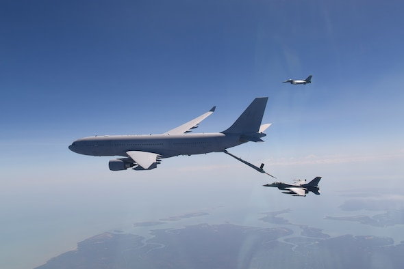 A pair of U.S. Air Force F-16 Fighting Falcons, assigned to Kunsan Air Base, Republic of Korea, fly over the Northern Territory, Australia, while receiving air-to-air refueling from a Royal Australian Air Force KC-30A Multi-Role Tanker Transport aircraft during Exercise Pitch Black 2018, Aug. 7, 2018. This training focuses on exercising international forces in the planning and execution of large-scale offensive, counter-air and counter-land operations in a coalition environment against a capable adversary force. (U.S. Air Force photo by Senior Airman Savannah L. Waters)