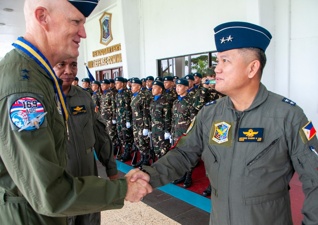Maj. Gen. James O. Eifert, Air National Guard Assistant to the Commander, Pacific Air Forces shakes hands with Philippine Air Force Maj. Gen. Antonio Ramon A. Lim