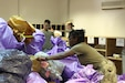 On July 19, members of the 328th Human Resources Company, supported by the 787th Combat Sustainment Support Battalion, along with a few other volunteers from units across the camp, received and sorted 500 bags of mail.  The bags of mail were stacked almost to the ceiling of the mailroom and all down the hallways.  (Photo by Staff Sgt. Charlotte Reavis, 143d Sustainment Command (Expeditionary))