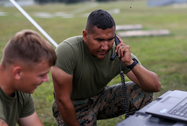 Marines with Marine Aircraft Group 13 communicate with Marines at Marine Corps Air Station Miramar utilizing high frequency communication equipment during Exercise Northern Lightning at Volk Field Counterland Training Center, Camp Douglas, Wis. Aug. 16. Exercise Northern Lightning 2018 allows the Air Force, Marine Corps and Navy to strengthen interoperability between services and gives the different branches a greater understanding of aviation capabilities within a joint fighting force.