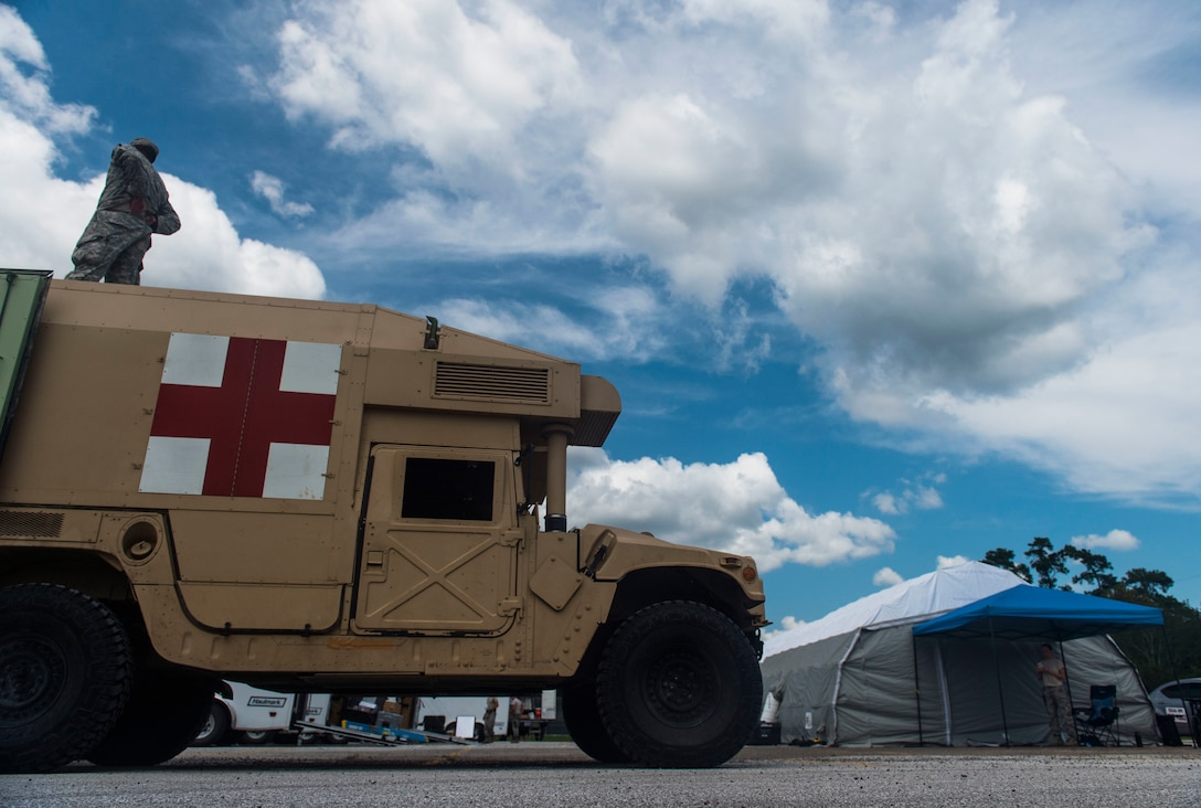 Nebraska Air National Guard Airman from the 155th Medical Group, Lincoln Air National Guard Base, Nebraska, set up a field hospital in Vidor, Texas, to assistant local residents with medical care after Hurricane Harvey, Sept. 5, 2017. The field hospital, set up in the parking lot of Vidor High school, allowed residents easy access to medical care in areas heavily affected by Hurricane Harvey. (U.S. Air Force photo by Airman 1st Class Nicholas Dutton)