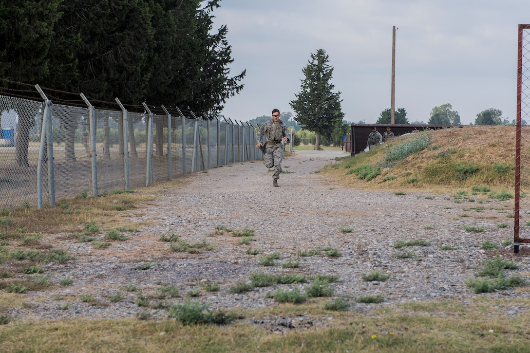 An Airman runs during shooting drills at CATM