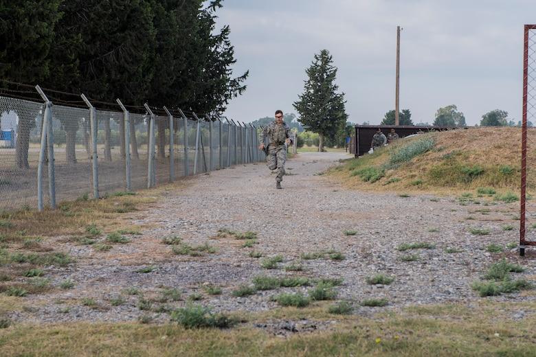 An Airman runs during shooting drills at CATM