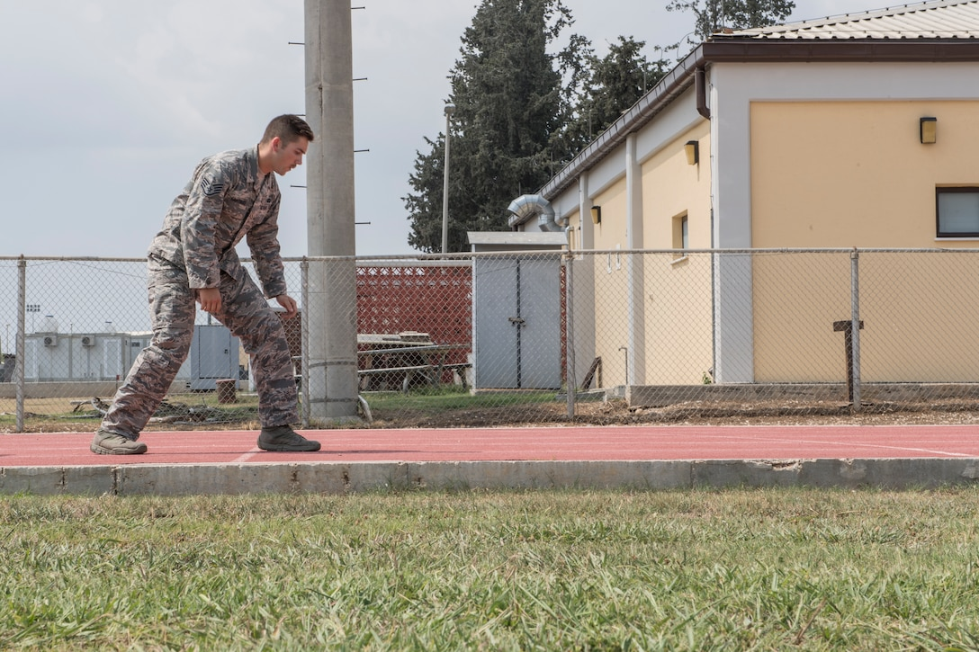 An Airman prepares to begin an obstacle course