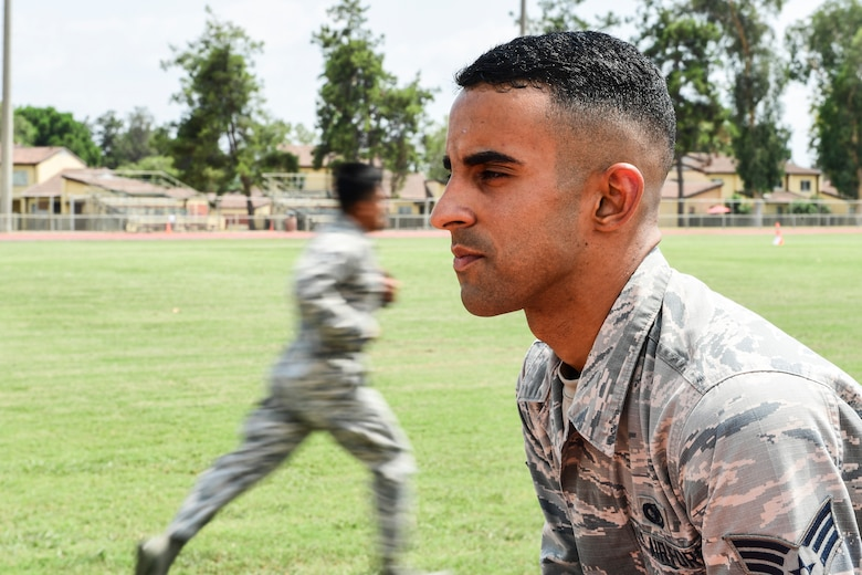 An Airmen prepares to run an obstacle course.