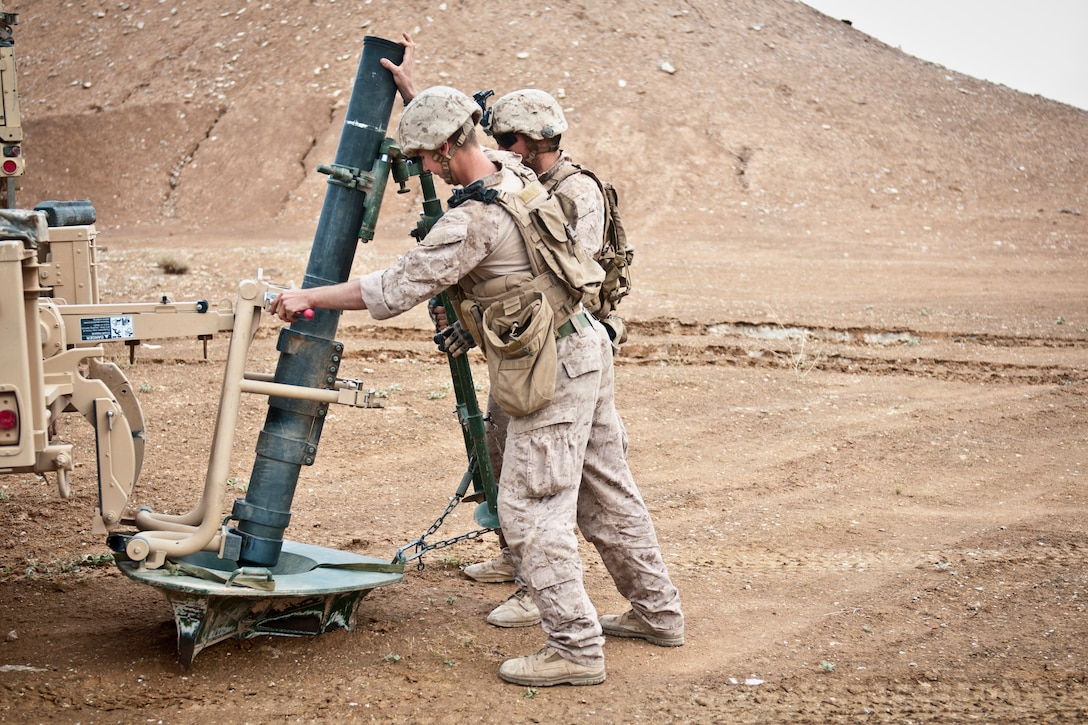 Coalition forces prepare to fire a mortar.