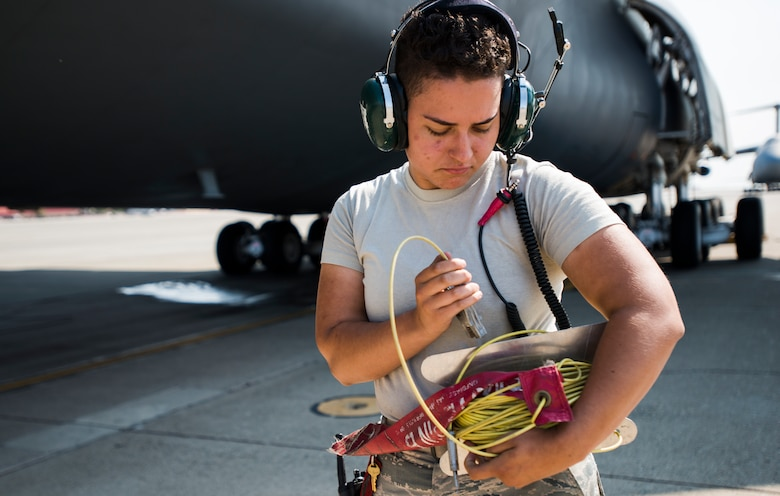 Airman 1st Class Tatiana Orr, 60th Aircraft Maintenance Squadron crew chief, wraps power chords prior to the launch of C-5M Super Galaxy on Aug. 12, 2018, at Travis Air Force Base, Calif. The 349th and 60th AMXS work together to launch aircraft in a seemless active duty and Air Force Reserve integration.