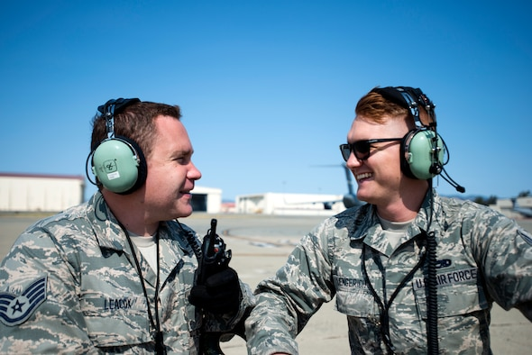Staff Sgt. Taylor Leacox and Senior Airman Daniel Lengerich, 349th Aircraft Maintenance Squadron crew chiefs, discuss next steps to take before a C-5M Super Galaxy can launch on Aug. 11, 2018, at Travis Air Force Base, Calif. The 349th and 60th AMXS work together to launch aircraft in a seemless active duty and Air Force Reserve integration.