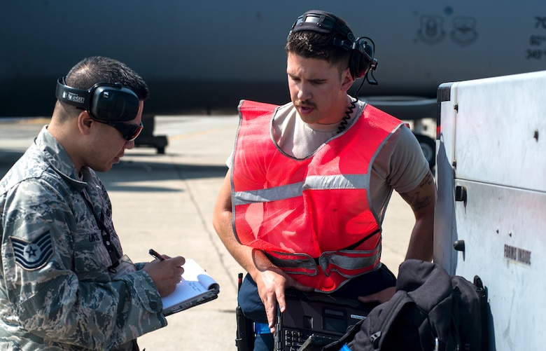 Tech. Sgt. Antonio Untal, 349th Aircraft Maintenance Squadron crew chief, debriefs Senior Airman Kyle Lake, 60th AMXS crew chief, after launching a C-5M Super Galaxy on Aug. 11, 2018, at Travis Air Force Base, Calif. The 349th and 60th AMXS work together to launch aircraft in a seemless active duty and Air Force Reserve integration.