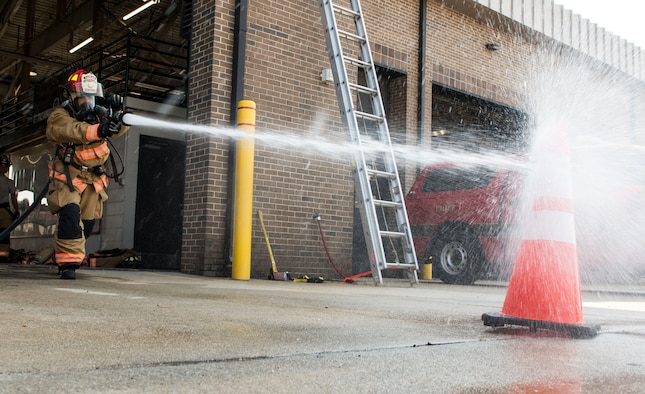 U.S. Air Force Senior Airman Christopher Moretto, 20th Civil Engineer Squadron fire protection apprentice, sprays a simulated fire during proficiency training at Shaw Air Force Base, S.C., Aug. 14, 2018.