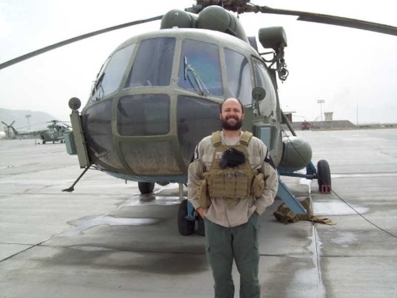 Matthew, Northrup-Grumman chief pilot, stands in front of his Russian Mil Mi-17 helicopter in Afghanistan in 2011. During this point in his career, Matthew also served in the U.S. Army Reserves while taking seminary classes online which would lead to his current assignment as a U.S. Air Force Chaplain at Creech Air Force Base, Nev. (Courtesy photo)