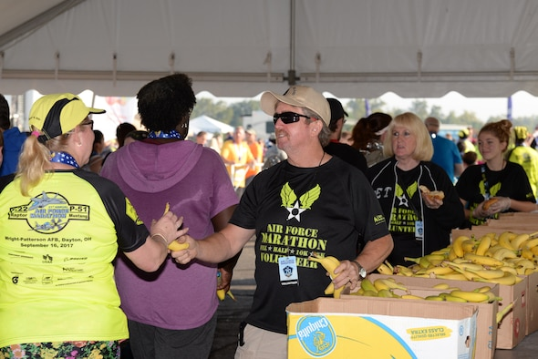 Air Force Marathon volunteers hand out bananas to runners after the finish line Sept. 16, 2017.