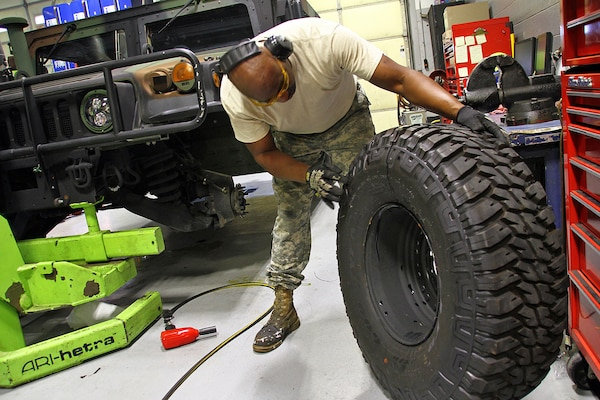 Sgt. Rudon Gay inspects a tire prior to installation on a Humvee at Field maintenance Shop #5 in Frankfort, Ky., Aug 17, 2018. More than 1,200 tires were considered damaged and replaced on Kentucky Guard vehicles after a defect was discovered in the Spring of 2018.