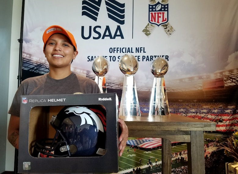 Tech. Sgt. Christine Lewis, 310th Security Forces Squadron, participated on a team that went head-to-head with nine other military teams during a National Football League-style boot camp Aug. 21, 2018, at the Denver Broncos' Dove Valley Fieldhouse in Englewood, Colorado.