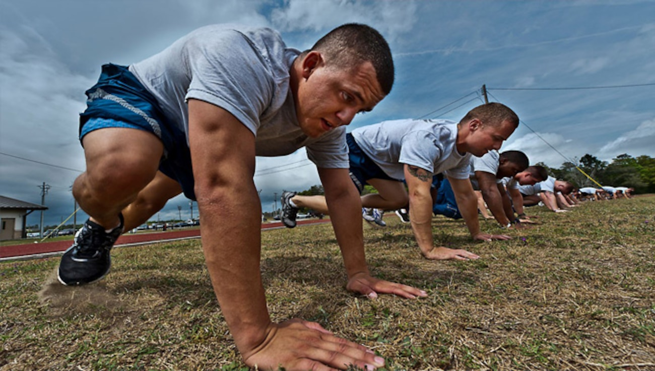 Photo depicting Airmen doing burpees, representing the Air Force Fitness Program