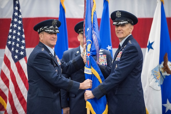 Gen. Timothy Ray accepts the Air Force Global Strike Command guidon from the Air Force Chief of Staff Gen. David L. Goldfein during a change of command ceremony at Barksdale Air Force Base, La., Aug. 21, 2018.