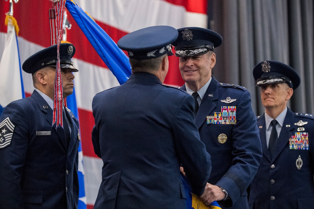 Gen. Robin Rand relinquishes the Air Force Global Strike Command flag to Air Force Chief of Staff Gen. David L. Goldfein