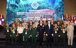 Lead delegates from 26 nations pose for a group photo following the opening ceremony for the 42nd Pacific Armies Management Seminar and 4th Senior Enlisted Leader Forum, 20 Aug. 2018, Hanoi, Vietnam. USARPAC, headquartered in Honolulu, Hawaii, and another Indo-Pacific country have co-hosted the event annually since 1977. The seminar is a forum for senior-level land force officers to meet and discuss professional military subjects on a non-attribution basis. It has proven its value by enhancing mutually beneficial army-to-army associations, furthering the long-term objectives of promoting peace and stability in the Indo-Pacific region through understanding, dialogue, and interpersonal relationships. (Vietnam People's Army Newspaper)