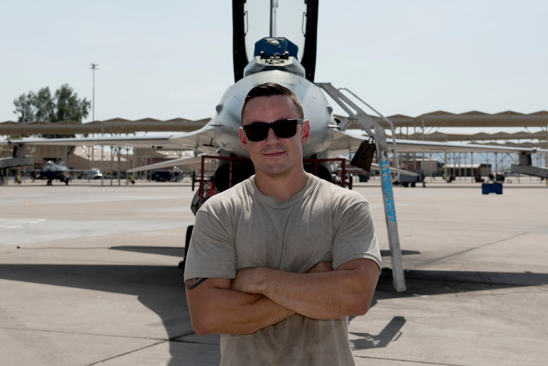 Staff Sgt. Tanner Apple, 309th Aircraft Maintenance Unit dedicated crew chief, poses for a photograph Aug. 20, 2018, at Luke Air Force Base, Ariz. Apple was awarded the 2017 Thomas N. Barnes award for the best dedicated crew chief in the Air Force. (U.S. Air Force photo by Senior Airman Ridge Shan)